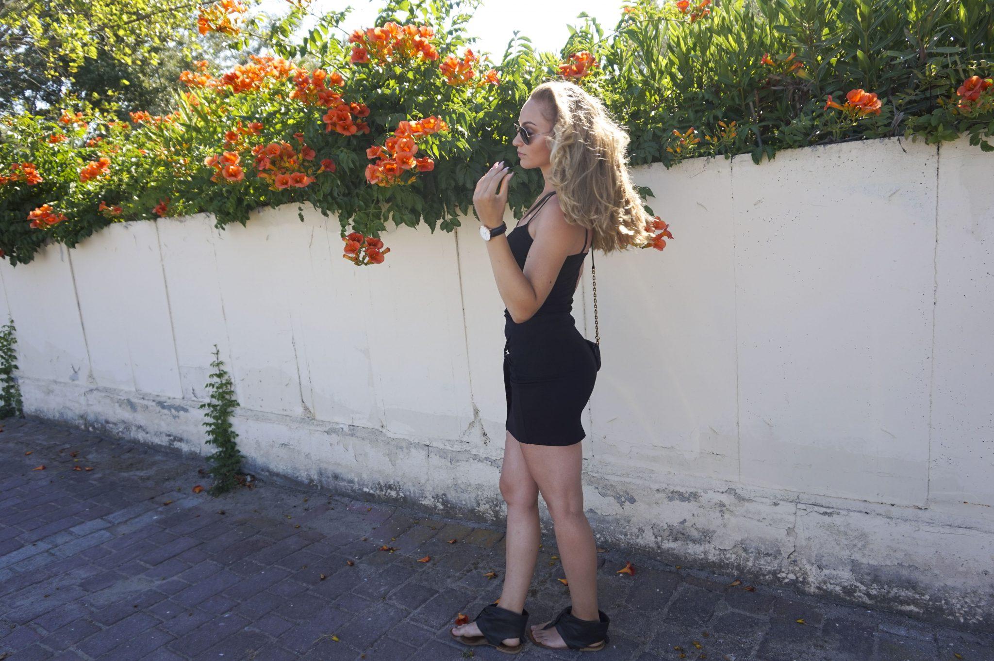 black outfit wall paralia katerini rayban daniel wellington