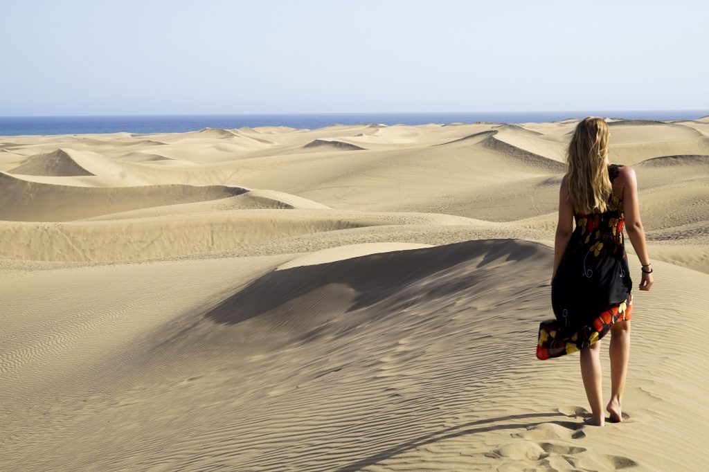 Standing in the dunes of Maspalomas with a long flower dress