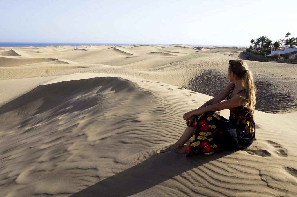 Sitting on the sand dunes in maspalomas gran canaria