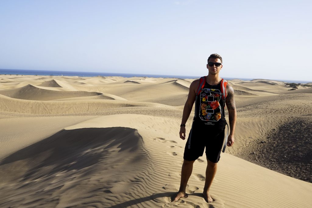 My boyfriend standing on a sand dune in maspalomas gran canaria