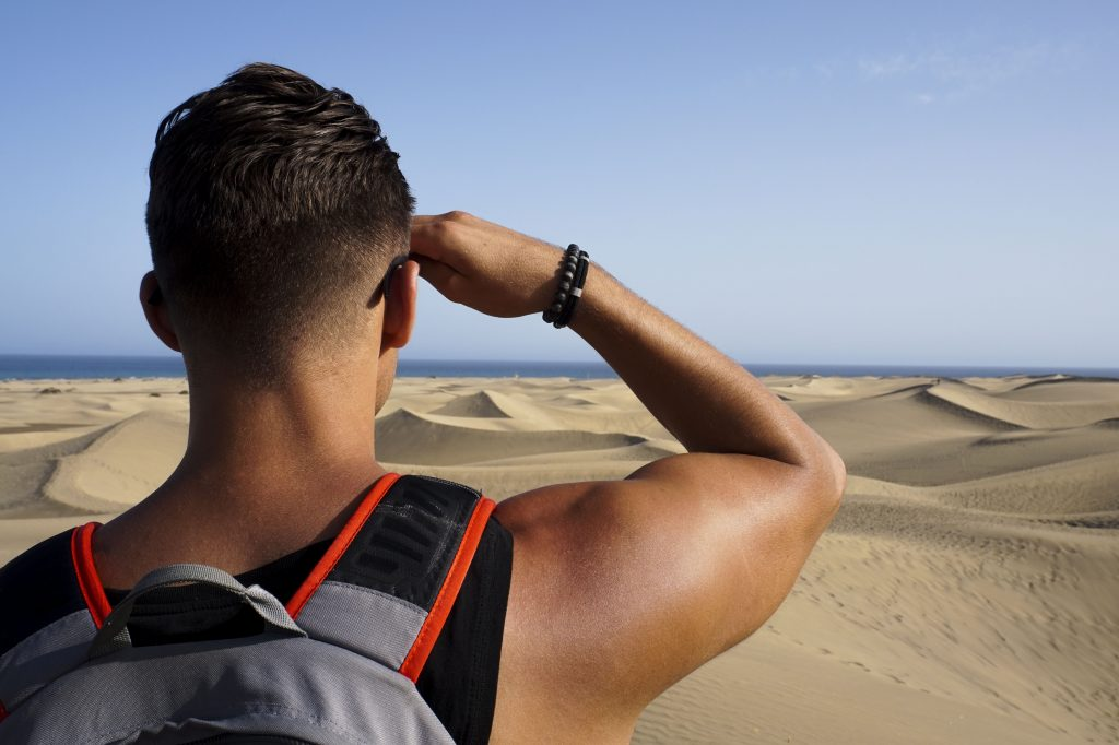 my boyfriend looking into the far desert in gran canaria