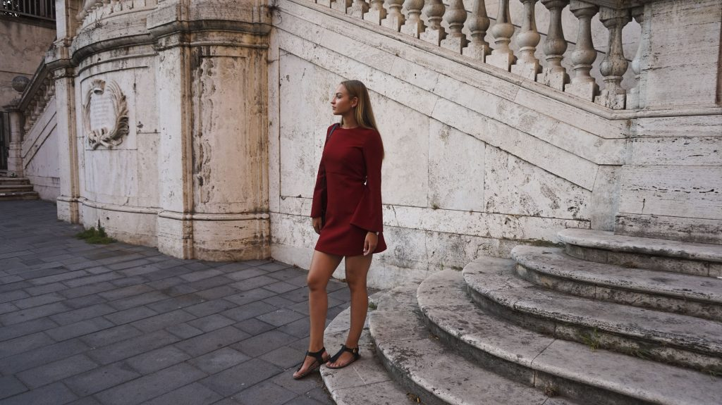 standing in rome in the red flared sleeves dress from mango