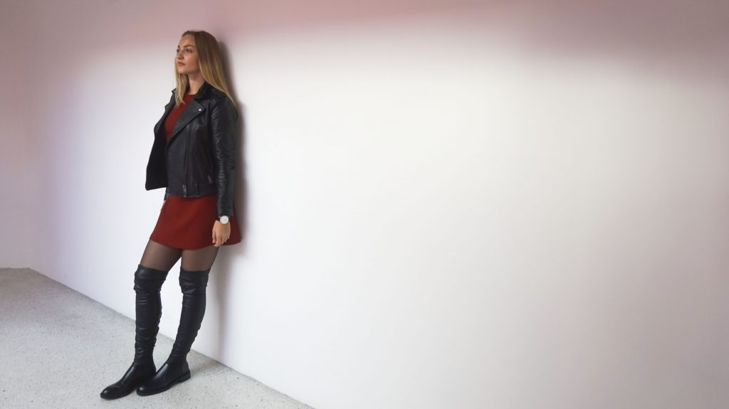 2f724ca63f40 leaning against the wall with diesel leather jacket flared sleeves dress  and black leather over knees