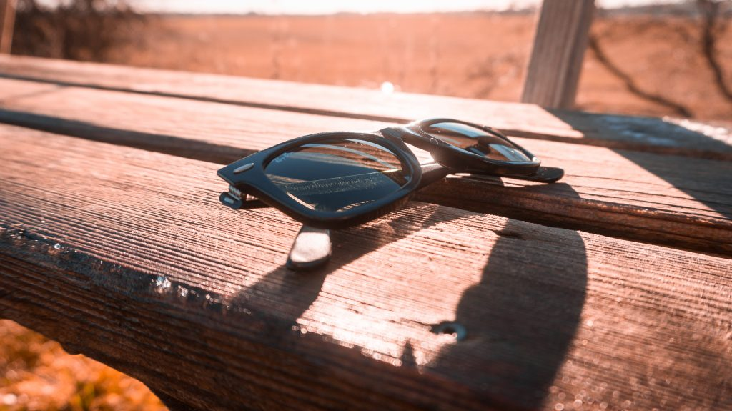 icey weather cold winter ice street frost rayban sunglasses closeup