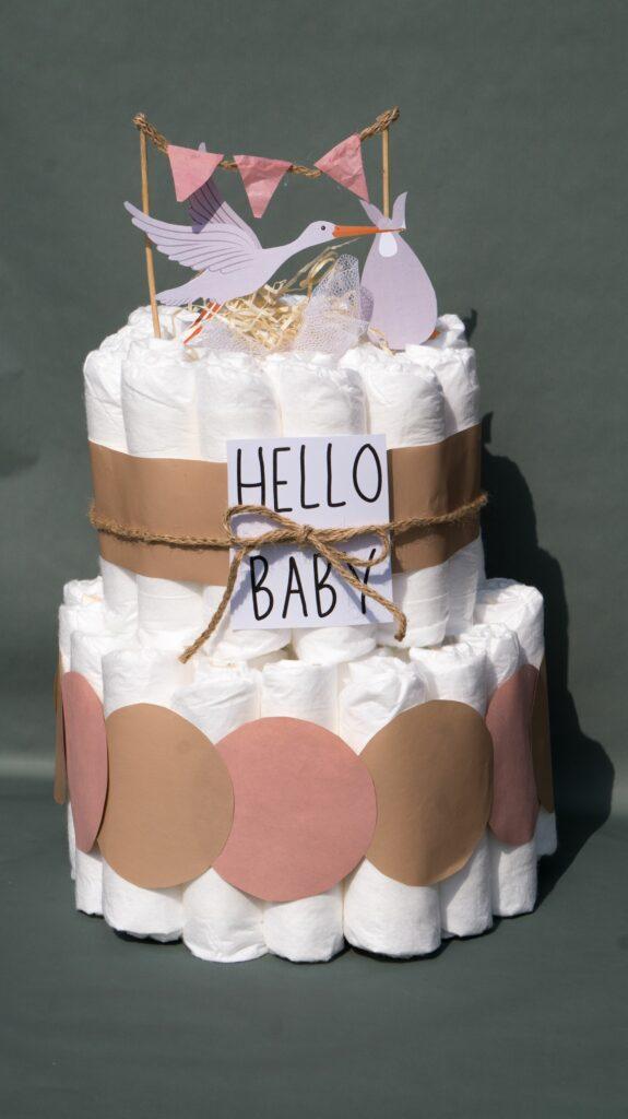2 tier girl themed diaper cake for girl with stork nest on top